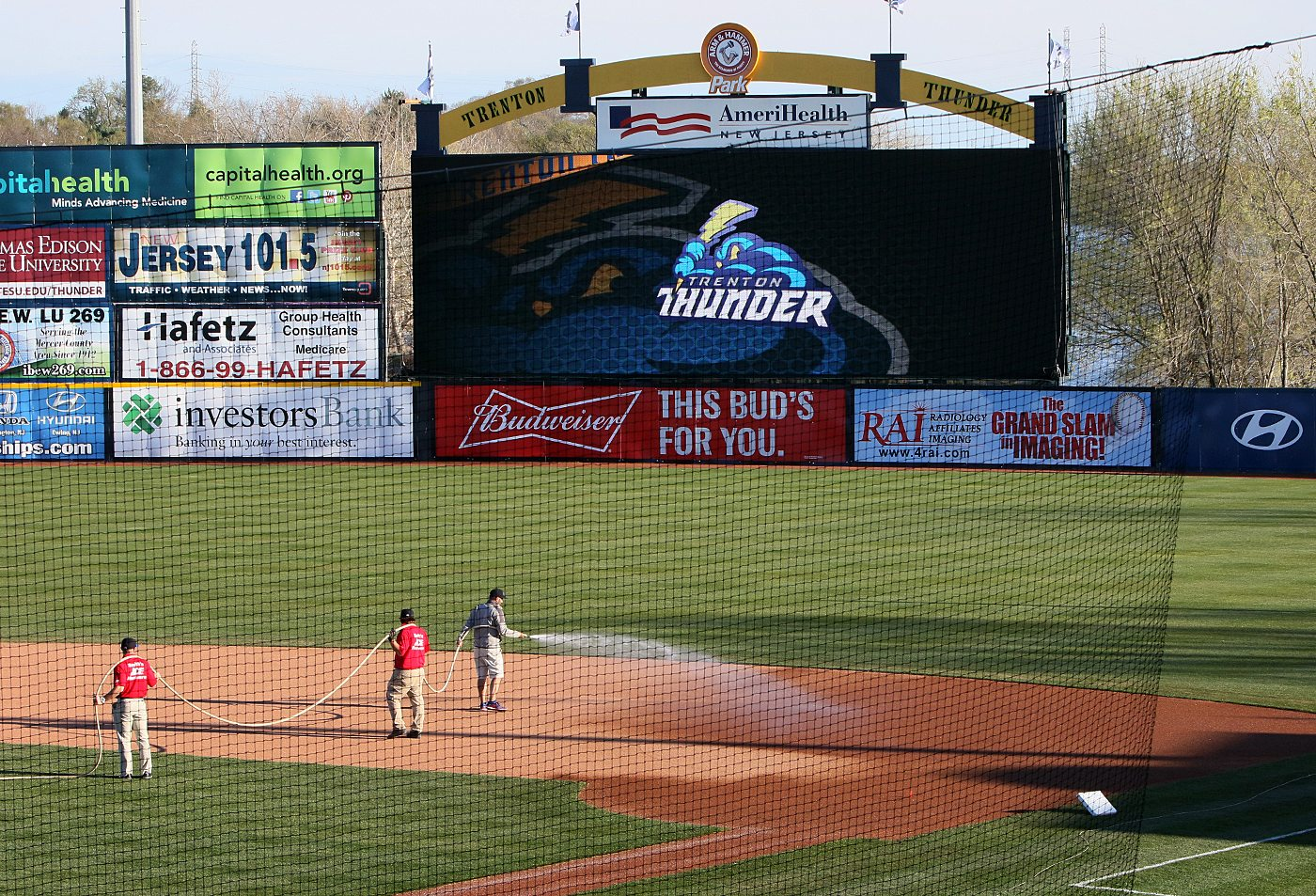 The grounds crew prepares the infield for a game between the Trenton and Portland Sea Dogs at Arm & Hammer Park in Trenton on Tuesday, April 12, 2016. Photo by Martin Griff