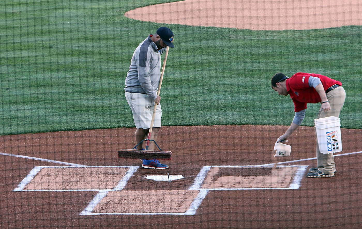 Members of the grounds crew prepare the batter's box for a game between the Trenton and Portland Sea Dogs at Arm & Hammer Park in Trenton on Tuesday, April 12, 2016. Photo by Martin Griff