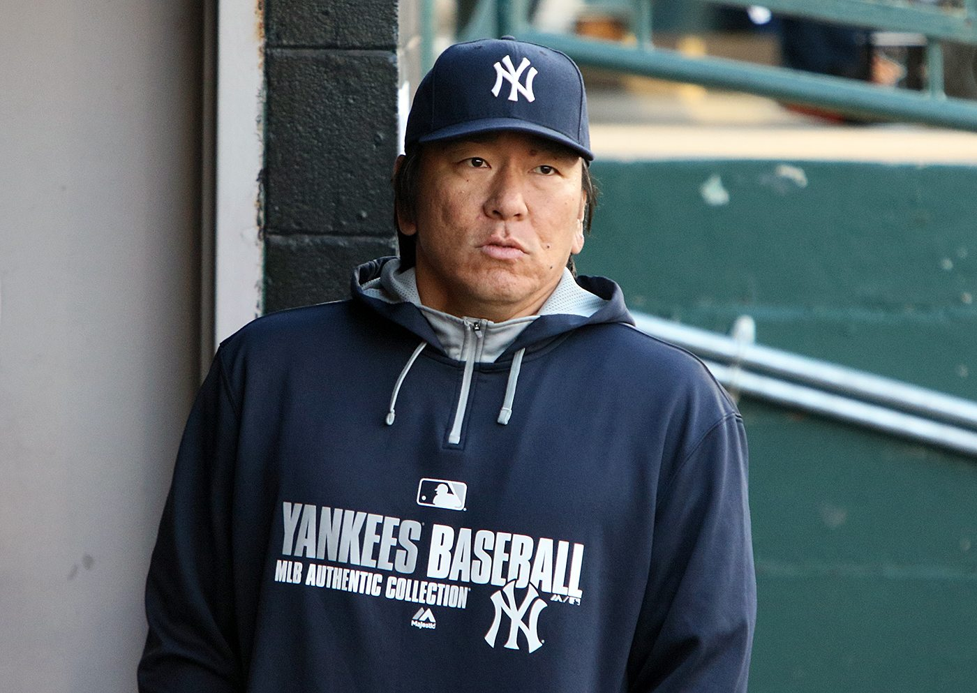 "Hideki ""Godzilla"" Matsui, a special adviser to New York Yankees general manager Brian Cashman looks out from the AA Trenton Thunder dugout during a game against the Portland Sea Dogs at Arm & Hammer Park in Trenton on Tuesday, April 12, 2016. Photo by Martin Griff."