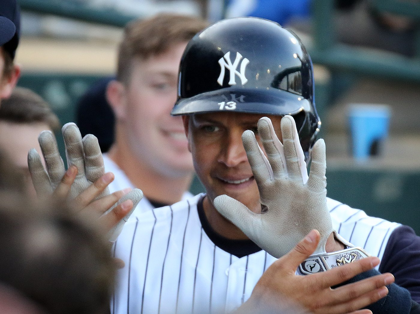 New York Yankees slugger Alex Rodriguez returns to the dugout at ARM & HAMMER Park in Trenton on Wednesday, May 25, 2016 after hitting a second inning home run during game against the New Hampshire Fisher Cats. Rodriguez joined the Double A Yankee farm team for a second day as part of a rehab assignment. Photo by Martin Griff