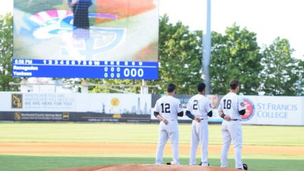 The Staten Island Yankees salute the flag for the National Anthem (Robert M. Pimpsner)