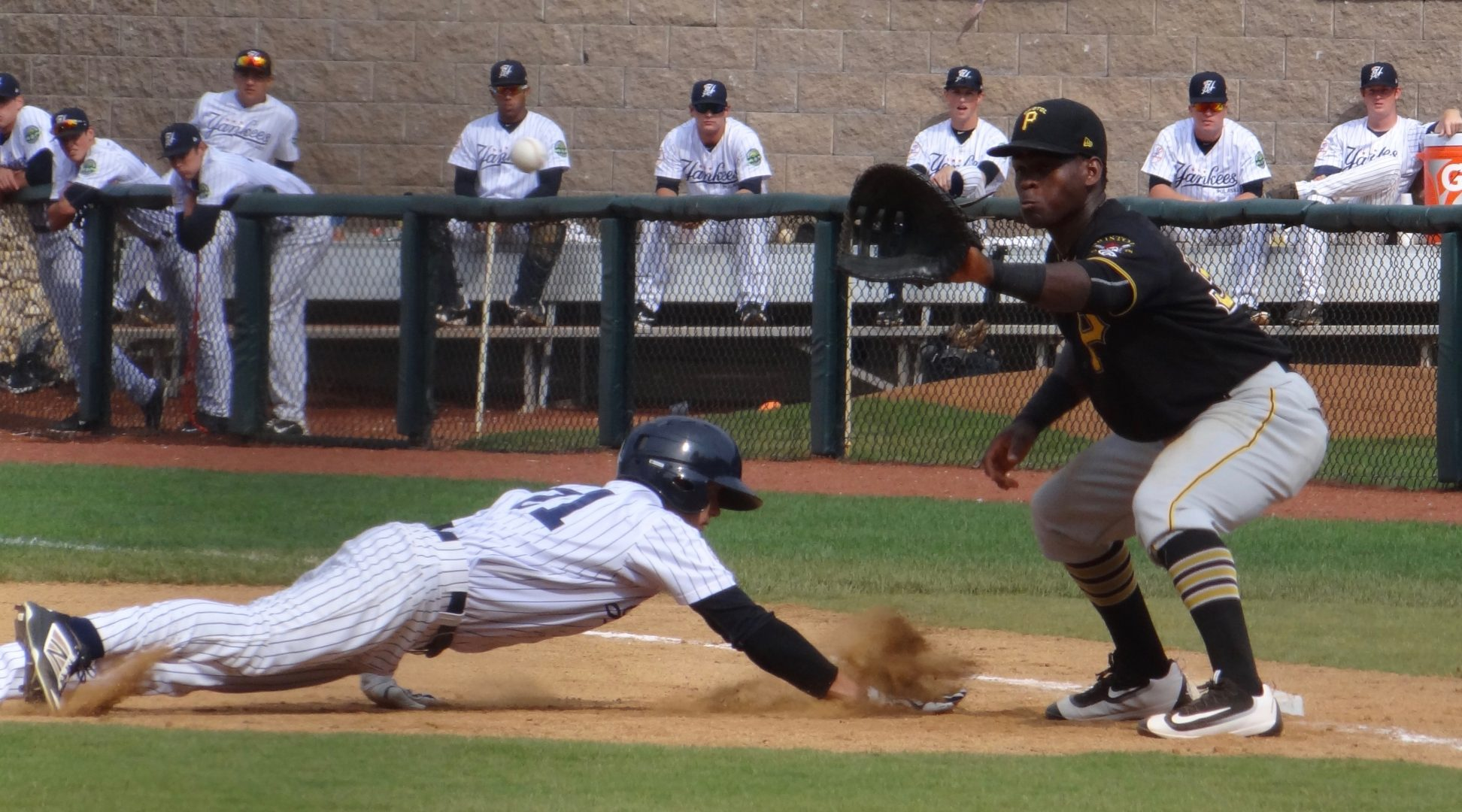 Ben Ruta diving back to first base. (Jarah Wright)