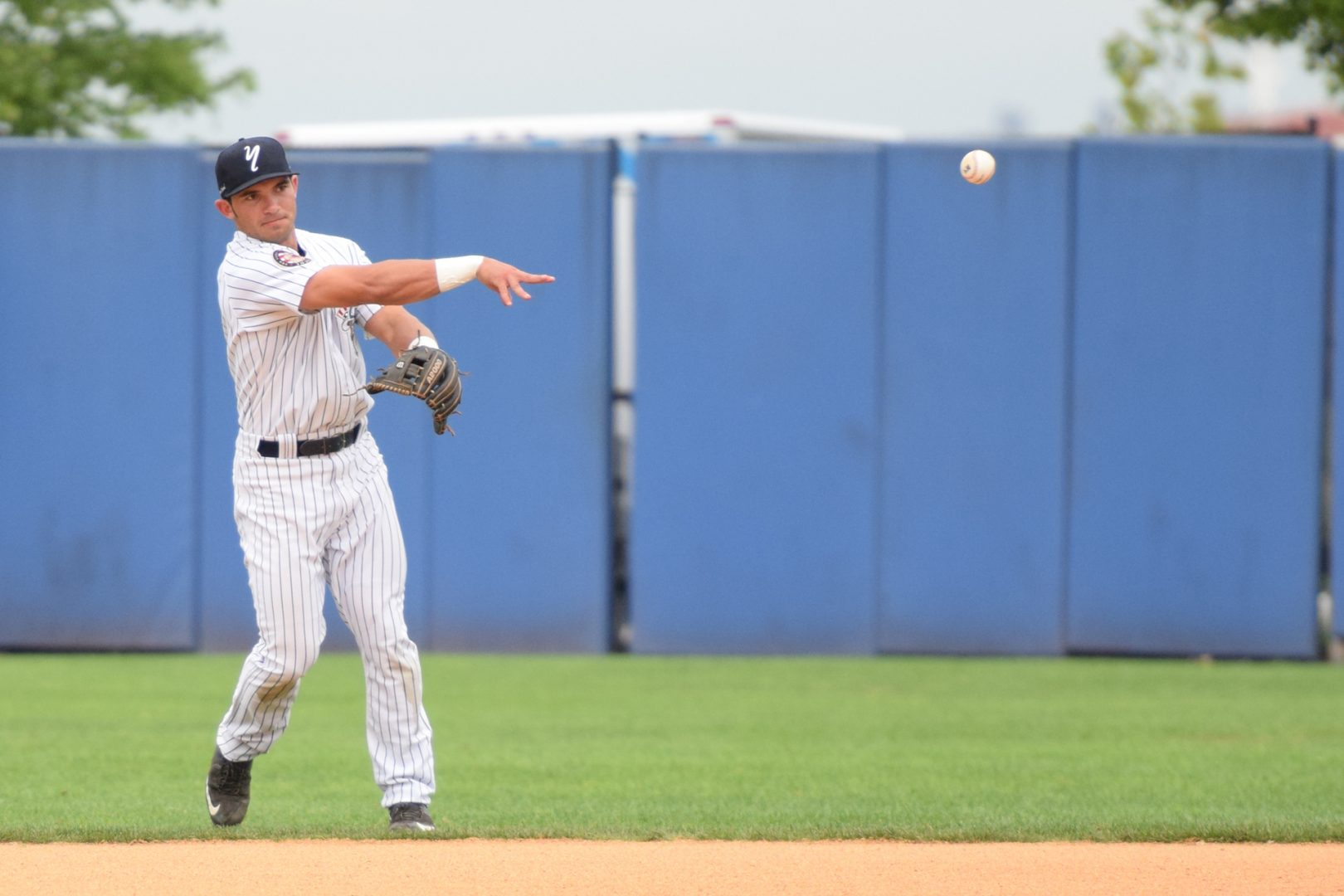 Second baseman Chris Godinez fields the ball and throws to first to end the first inning. (Robert M. Pimpsner)