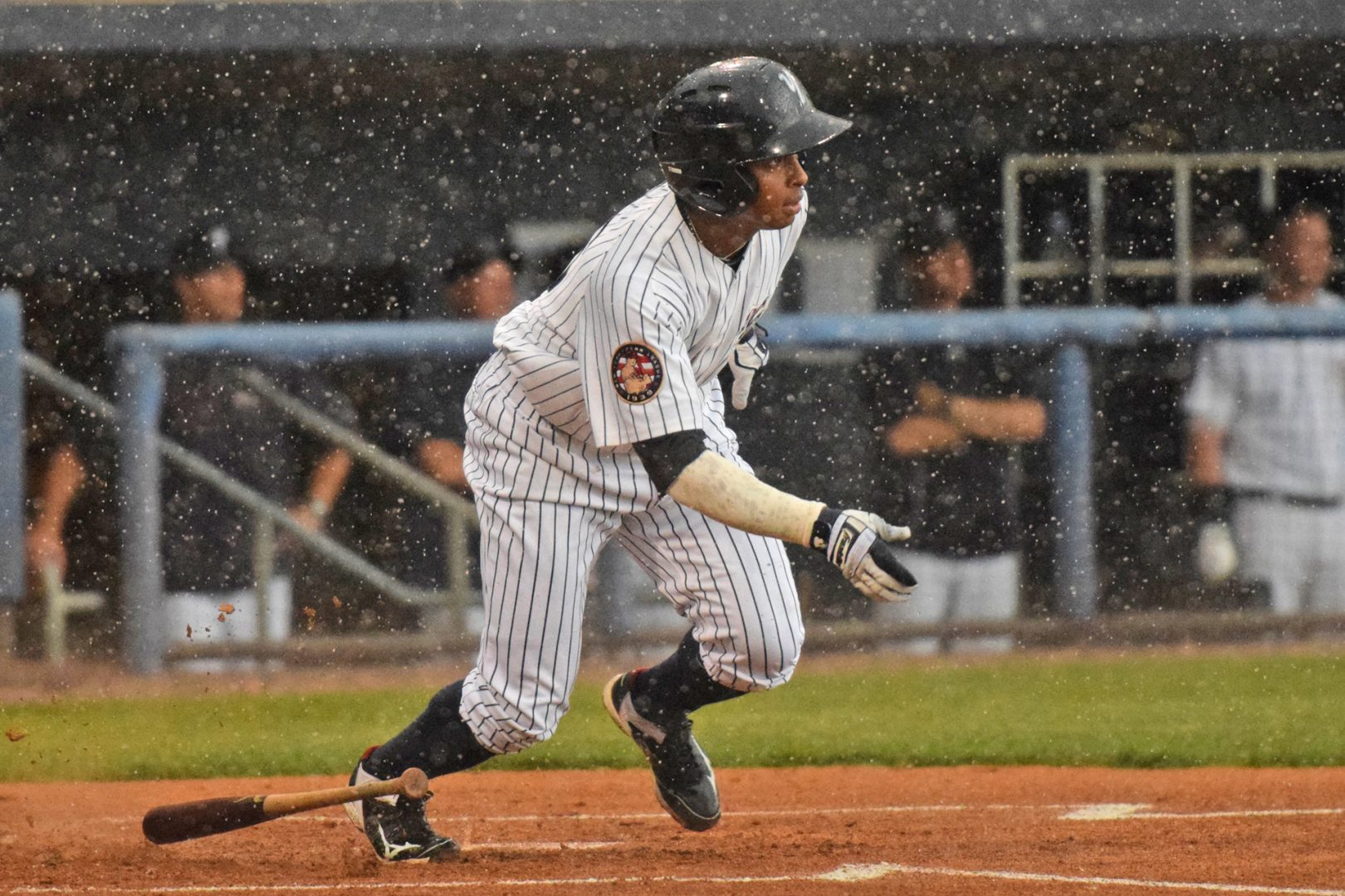 During the middle of the first inning the rain started to come down, only Ricardo Ferriera got up to bat in the bottom half with the rain pouring down. (Robert M. Pimpsner)