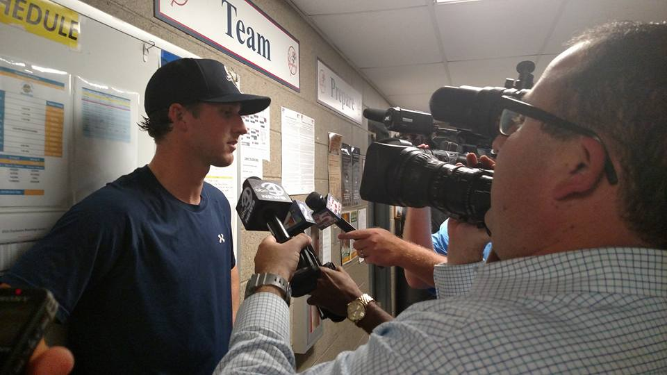 Bryan Mitchell talking to the press after the game. (Joe Dixon)