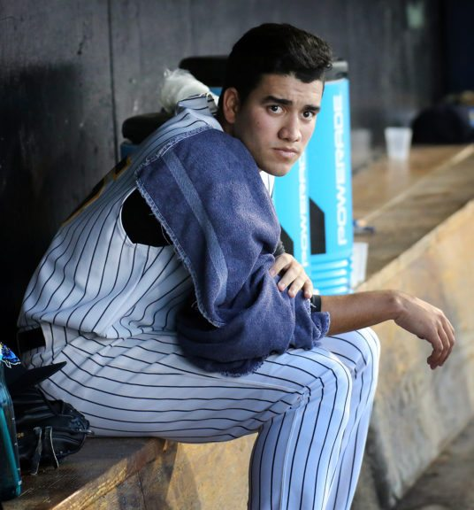 Trenton Thunder starting pitcher Ronald Herrera in the dugout against the Reading Fightin Phils in Game 1 of the Divisional Series of the Eastern League Playoffs at ARM & HAMMER Park in Trenton on Wednesday, September 7, 2016. Photo by Martin Griff