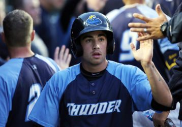 Trenton Thunder shortstop Tyler Wade is congratulated in the dugout after scoring a run against the Akron Rubberducks at ARM & HAMMER Park in Trenton on Friday, April 22, 2016. The Thunder won the game 2-0. (Photo by Martin Griff)